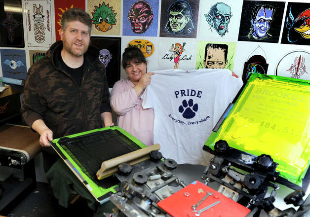 Paul Ledney, 43, and Meredith Ledney, 42, are the owners of Bethel T-Shirts Plus, on Greenwood Avenue in Bethel, Conn. Photo: Carol Kaliff / The News-Times