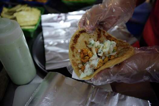 A chicken vindaloo taco on pita bread from Bombay Salsa Company, a food truck that fuses Latin American and Indian Cuisine. Photo: Helen L. Montoya, San Antonio Express-News / ©2013 San Antonio Express-News