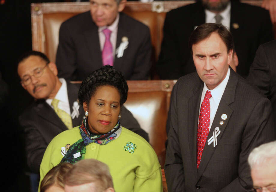 On the aisle, sitting next to Republican Rep. Pete Olson of Sugar Land, 2011. Photo: Lauren Victoria Burke, Lauren Victoria Burke/WDCPIX.COM / Lauren Victoria Burke