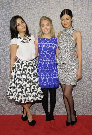 (L-R) Actresses Vanessa Hudgens, AnnaSophia Robb and Victoria Justice attend the Alice + Olivia By Stacey Bendet Fall 2013 fashion show presentation during Mercedes-Benz Fashion Week on February 11, 2013 in New York City. Photo: Michael Loccisano, Getty Images / 2013 Getty Images