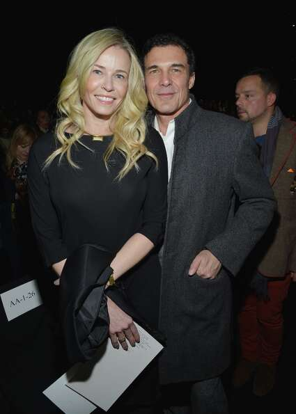 Chelsea Handler and Andre Balazs attend the Diane Von Furstenberg Fall 2013 fashion show during Merc