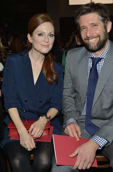 Actress Julianne Moore and Bart Freundlich attend the Tommy Hilfiger Women's Fall 2013 fashion show