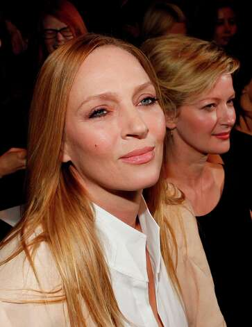 Uma Thurman and Gretchen Mol are seen at the Fall 2013 Donna Karan Runway Show, on Monday, February  11, 2013 in New York. (Photo by Amy Sussman/Invision/AP) Photo: Amy Sussman, Associated Press / Invision