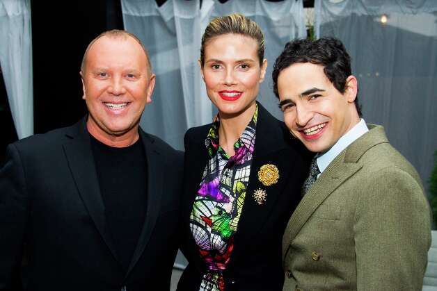 Michael Kors, from left, Heidi Klum and Zac Posen pose before the Fall 2013 Project Runway fashion show on Friday, Feb. 8, 2013 in New York. (Photo by Charles Sykes/Invision/AP) Photo: Charles Sykes, Associated Press / Invision