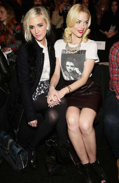 Ashlee Simpson (L) and actress Jamie King attend the Rebecca Minkoff Fall 2013 fashion show with TRE