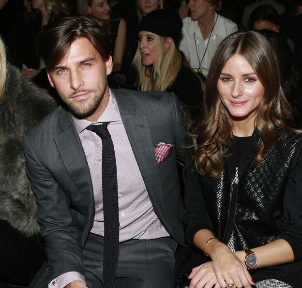 Johannes Huebl (L) and Olivia Palermo attend the Tibi fall 2013 fashion show during Mercedes-Benz Fa