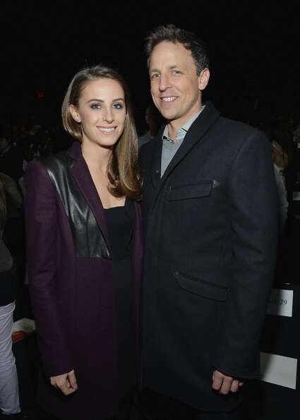 Alexi Ashe and Seth Meyers attend the Diane Von Furstenberg Fall 2013 fashion show during Mercedes-B