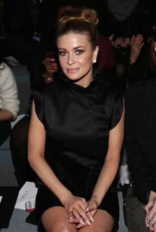 Carmen Electra attends the Vivienne Tam Fall 2013 fashion show with TRESemme during Mercedes-Benz Fashion Week at The Stage at Lincoln Center on February 10, 2013 in New York City. Photo: Astrid Stawiarz, Getty Images For TRESemme / 2013 Getty Images