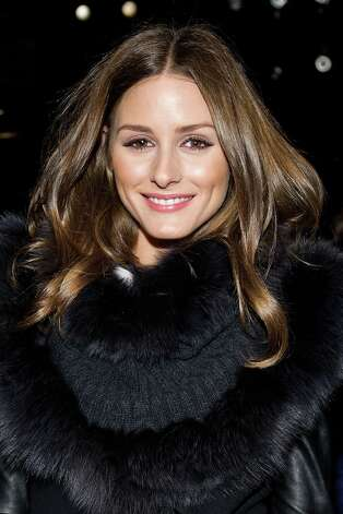 Olivia Palermo attends the Fall 2013 Carolina Herrera Runway Show, on monday, February 11, 2013 in New York. (Photo by Dario Cantatore/Invision/AP) Photo: Dario Cantatore, Associated Press / Invision