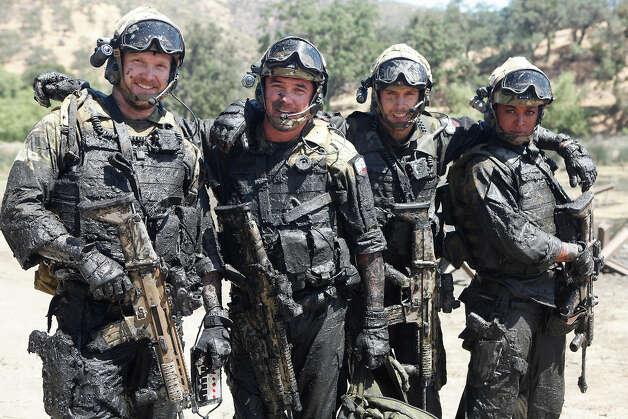Former Navy SEAL Chris Kyle  left  Dean Cain  Talon Smith and Laila    Chris Kyle Navy Seal Uniform