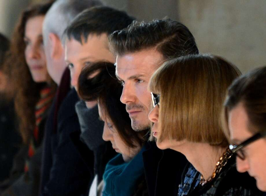 David Beckham (C) sits next to Vogue magazine editor Anna Wintour (2nd-R) at the Victoria Beckham show during the Mercedes-Benz Fashion Week Fall 2013 collections on February 10, 2013 in New York. AFP PHOTO/Stan HONDA Photo: STAN HONDA, AFP/Getty Images / AFP
