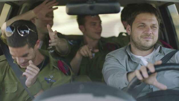 "Oz Zehavi (front left) and Ohad Knoller (driver) star in ""Yossi,"" a 2012 film directed by Eytan Fox. Photo: New York Times"