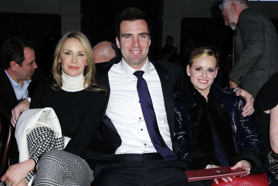 This image released by Starpix shows Dee Hilfiger, wife of designer Tommy Hilfiger, left, with Baltimore Ravens quarterback Joe Flacco and his wife Dana Grady at the Tommy Hilfiger Men's Fall 2013 collection, Friday, Feb. 8, 2013 during Fashion Week in New York. (AP Photo/Starpix, Andrew Toth) Photo: Andrew Toth, Associated Press / STARPIX