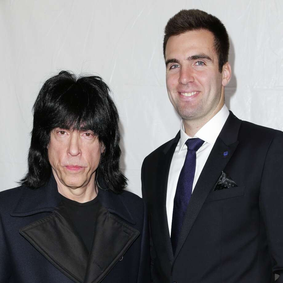 This image released by Starpix shows Ramones drummer Marky Ramone, left, and Baltimore Ravens quarterback Joe Flacco at the Tommy Hilfiger Men's Fall 2013 collection, Friday, Feb. 8, 2013 during Fashion Week in New York. (AP Photo/Starpix, Andrew Toth) Photo: Andrew Toth, Associated Press / STARPIX
