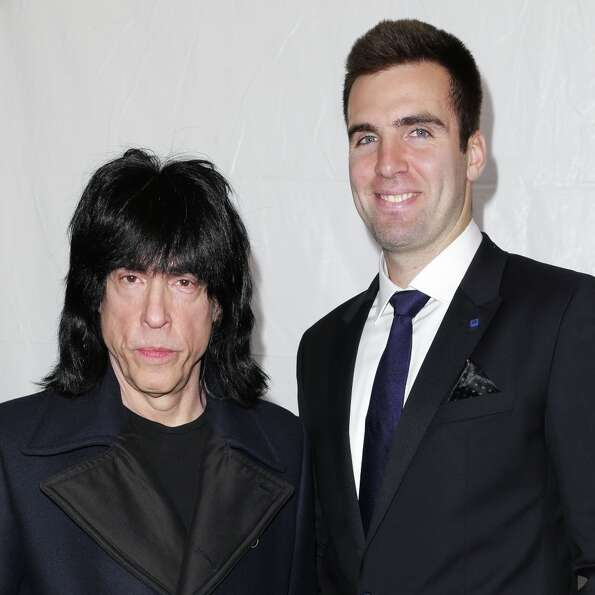 This image released by Starpix shows Ramones drummer Marky Ramone, left, and Baltimore Ravens quarte