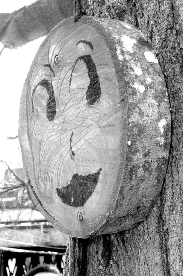 Have you noticed those mysterious pink smiley faces that have been showing up around town - nailed to local trees? Photo: Anne W. Semmes