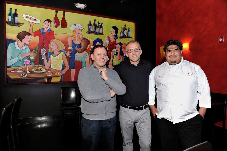 From left, Ignacio Blanco, Tony Cortereal and Juan Garcia are partners in Ibiza Tapas & Wine Bar in Danbury. Photo: Carol Kaliff / The News-Times
