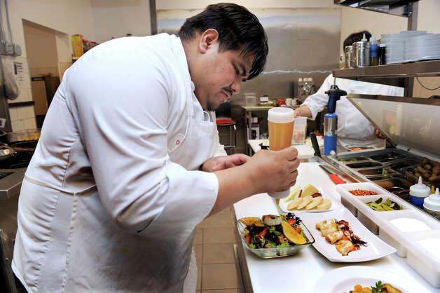 Juan Garcia, a partner and the chef at Ibiza Tapas & Wine Bar in Danbury, prepares dishes in the restaurant's kitchen Wednesday, Feb. 6, 2013. Photo: Carol Kaliff / The News-Times