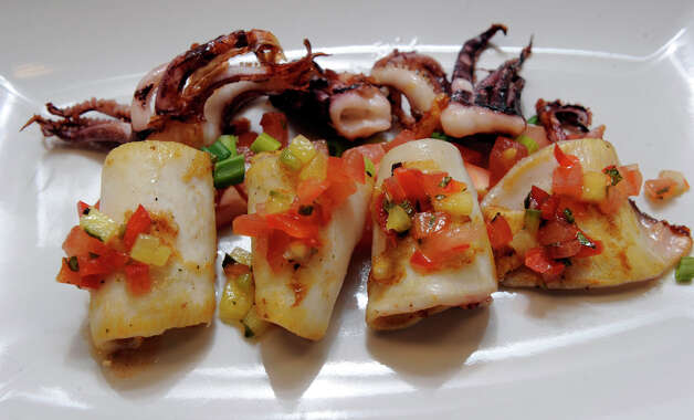 Grilled calamari is one of the dishes served at Ibiza Tapas & Wine Bar in Danbury Wednesday, Feb. 6, 2013. Photo: Carol Kaliff / The News-Times