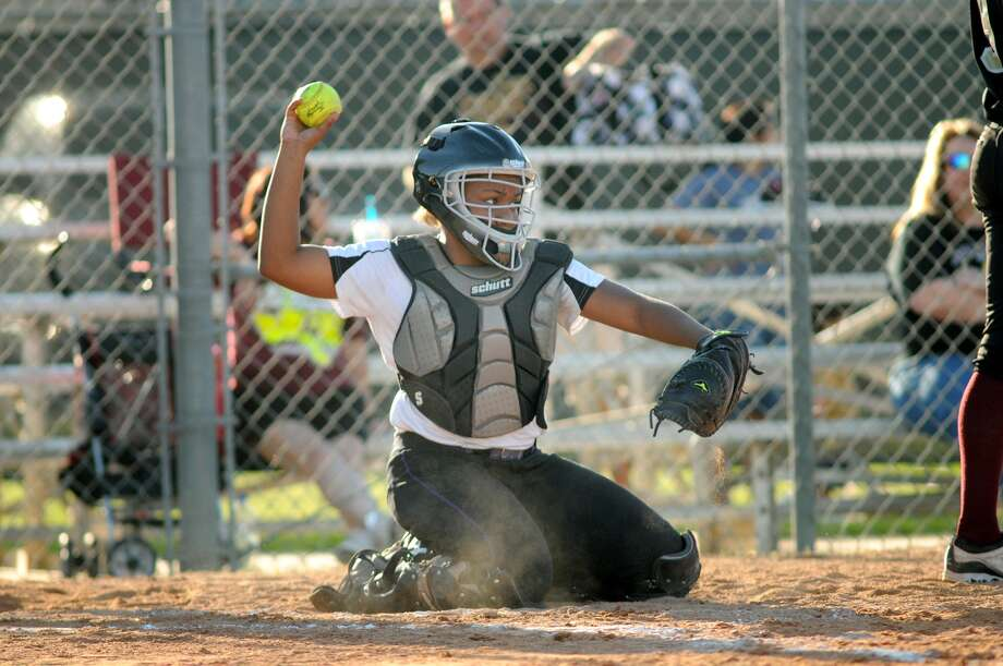 Humble Wildcats catcher Arianna Young makes a stop during a team practice last week. Photo: Jerry Baker, Freelance