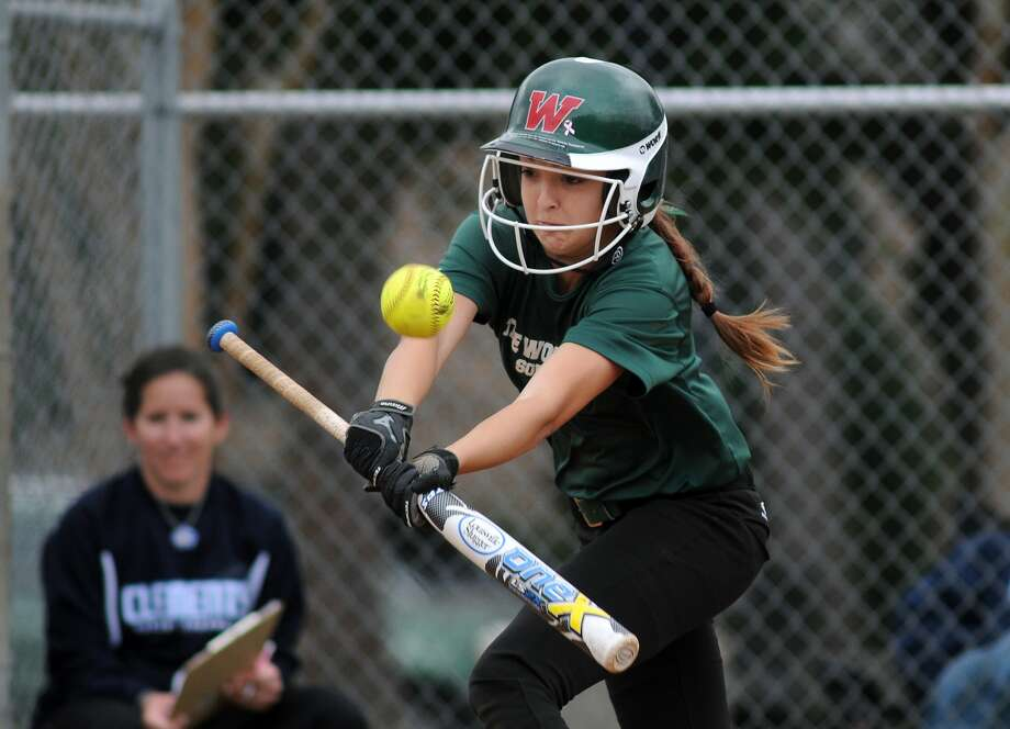 The Woodlands sophomore Kaitlyn Stavinoha lays down a bunt during the Lady Highlanders' scrimmage against Clements. Photo: Jerry Baker, Freelance