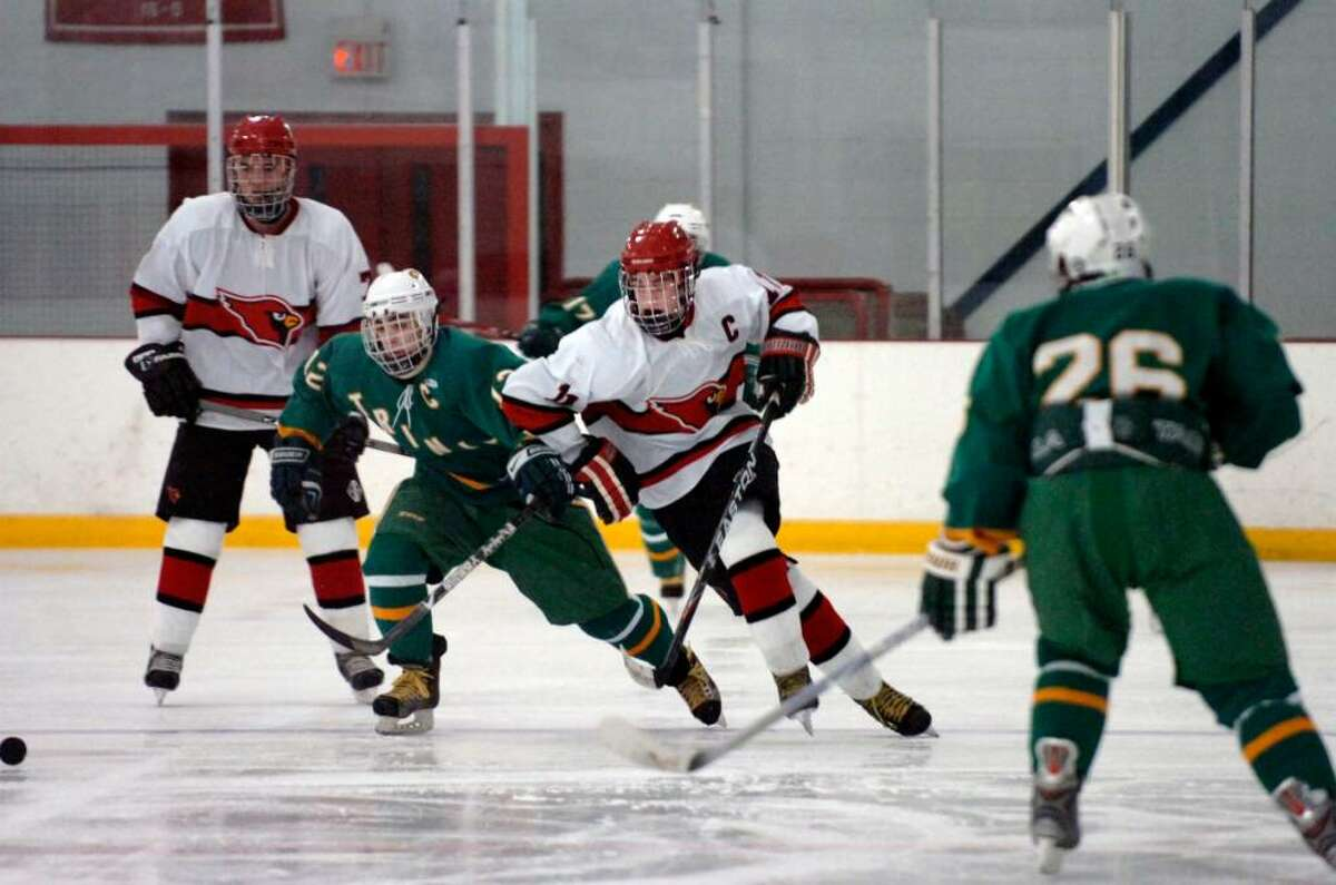 Byram, Dec. 28, 2009. GHS #11, Joey Lodato, center, behind him is Trinity Catholic #12 Chris Lambronakos, and GHS #7, far left, Woody Waesche at hockey game the Dorothy Hamill Skating Rink.