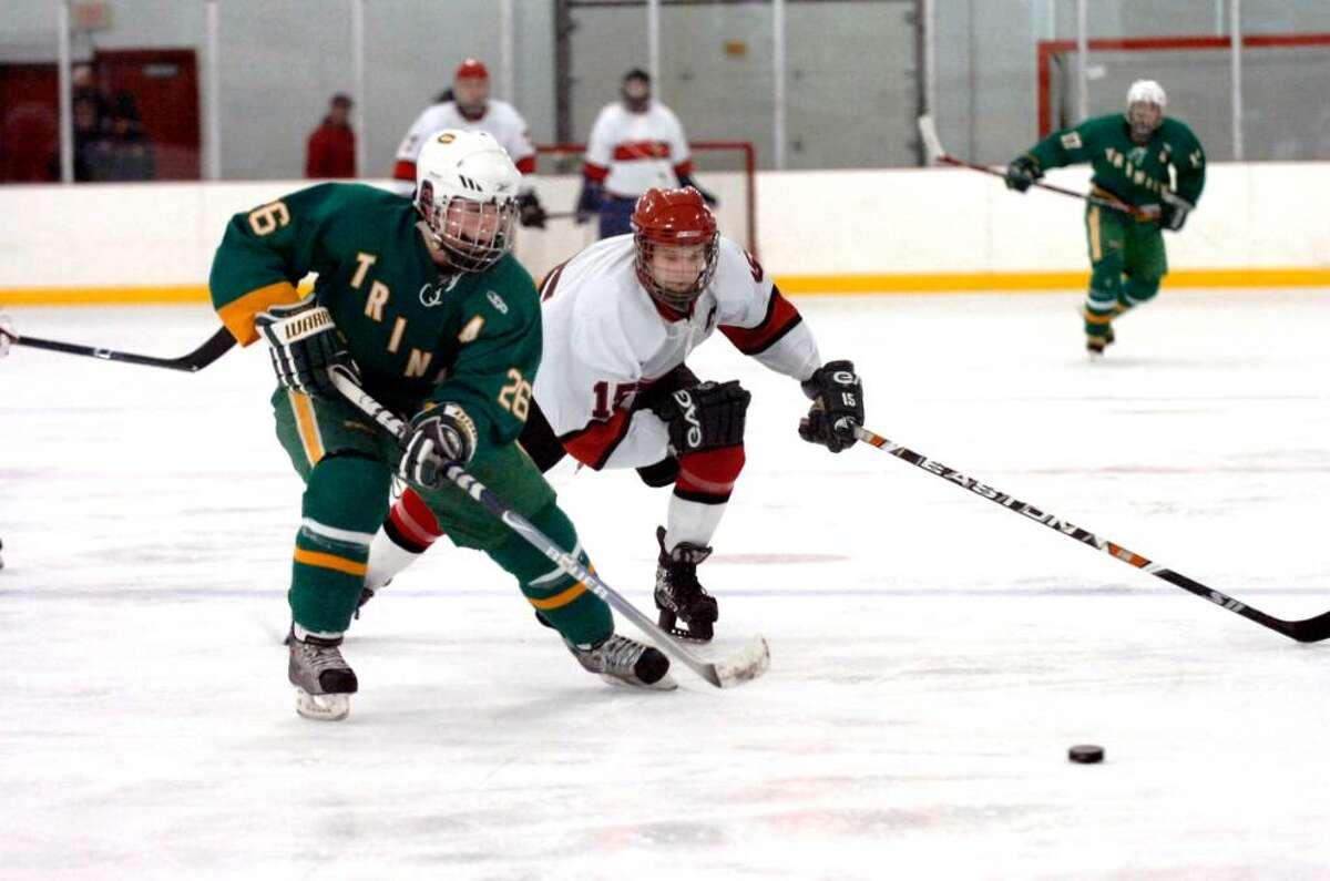 Byram, Dec. 29, 2009. Trinity Catholic # 26 Ryan Doherty and GHS #15 Rit Spezzano in the hockey game at Dorothy Hamill Skating Rink.