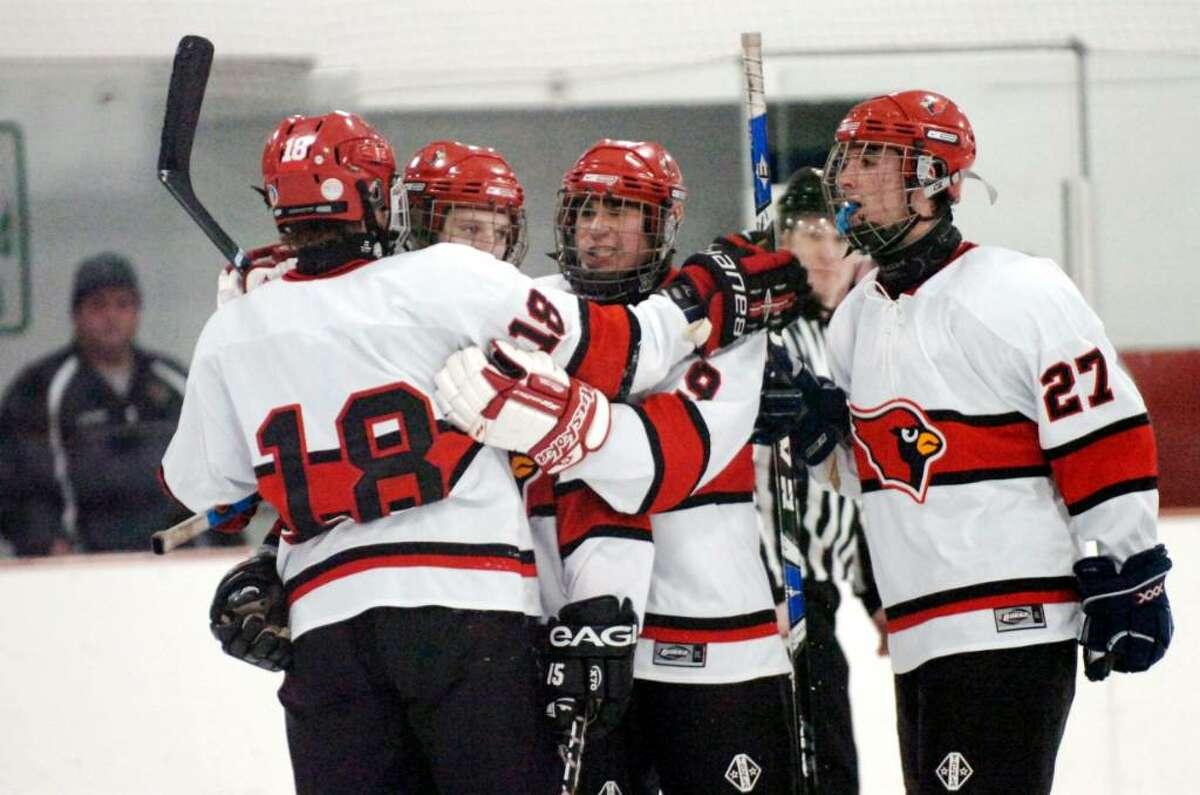 Byram, Dec. 28, 2009. Greenwich High School hockey players celebrate a score in the hockey game against Trinity Catholic at Dorothy Hamill Rink.