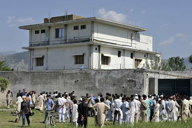 In this photograph taken on May 3, 2011, Pakistani media personnel and local residents gather outside the hideout of Al-Qaeda leader Osama bin Laden in Abbottabad following his death in a US Special Forces ground operation. Photo: Aamir Qureshi, AFP/Getty Images