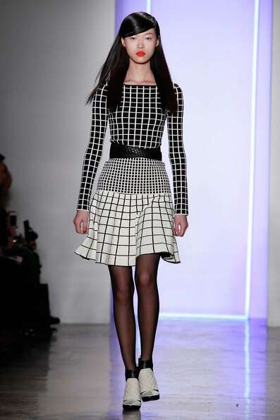 A model walks the runway at the Ohne Titel fall 2013 fashion show during MADE Fashion Week at Milk S