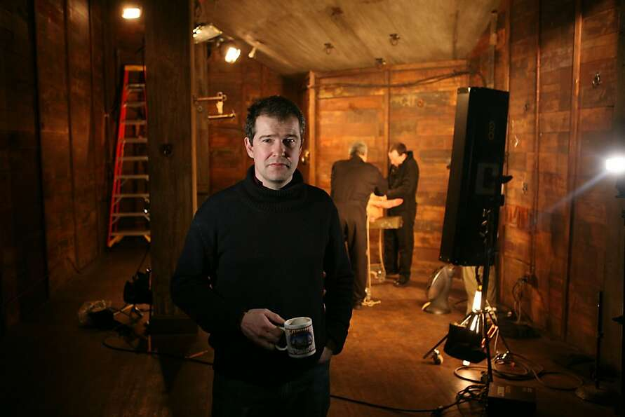 Peter Acworth, owner and CEO of Kink.com, stands for a portrait on a movie set in their office build