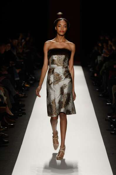 A model walks the runway at the Carolina Herrera Fall 2013 fashion show during Mercedes-Benz Fashion