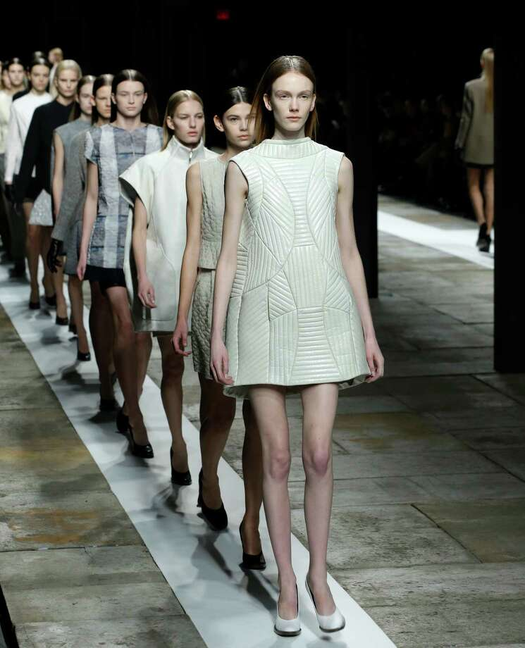 Models parade at the conclusion of the Theyskens Theory Fall 2013 runway show at Fashion Week in New York, Monday, Feb. 11, 2013.  Photo: Kathy Willens, Associated Press / AP