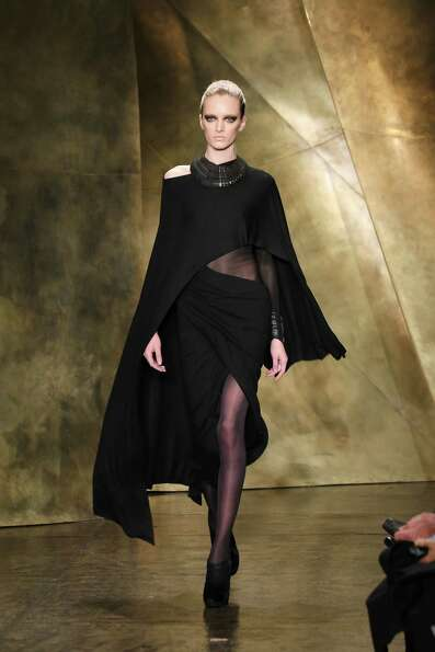 A model walks the runway at the Donna Karan New York Fall 2013 fashion show during Mercedes-Benz Fas