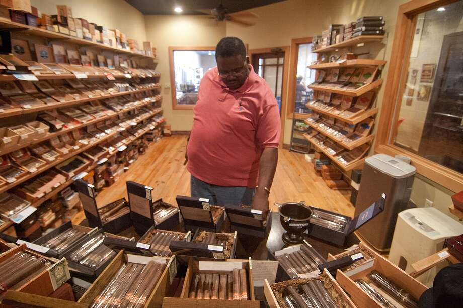 Frank Atkins confronts choices at Heights Cigar Lounge. Photo: R. Clayton McKee, Freelance / © R. Clayton McKee
