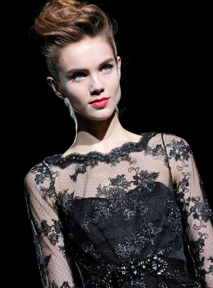 The Badgley Mischka Fall 2013 collection is modeled during Fashion Week, Tuesday, Feb. 12, 2013, in New York. (AP Photo/Louis Lanzano) Photo: Louis Lanzano, FRE / FR77522 AP