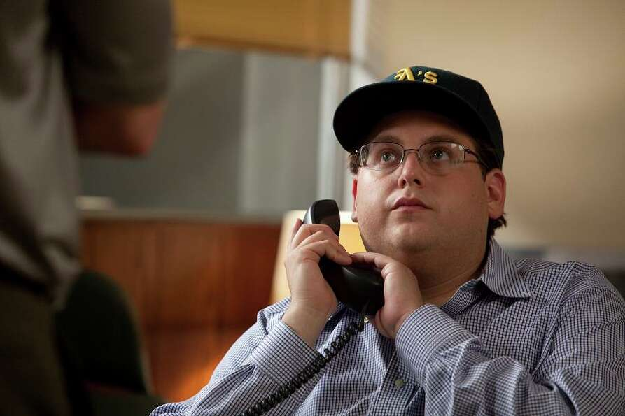 PETER BRAND (MONEYBALL, 2011): Jonah Hill's sabermetrics geek is based loosely on former Oakland A's
