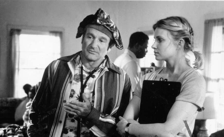 CARIN FISHER in PATCH ADAMS (1998): Many of the key characters in this Robin Williams movie were composites, including the love interest played by Monica Potter. The dastardly Dean Walcott is an even more obvious invention. We couldn't find a good photo of actor Bob Gunton. Photo: Universal Pictures / ONLINE_YES
