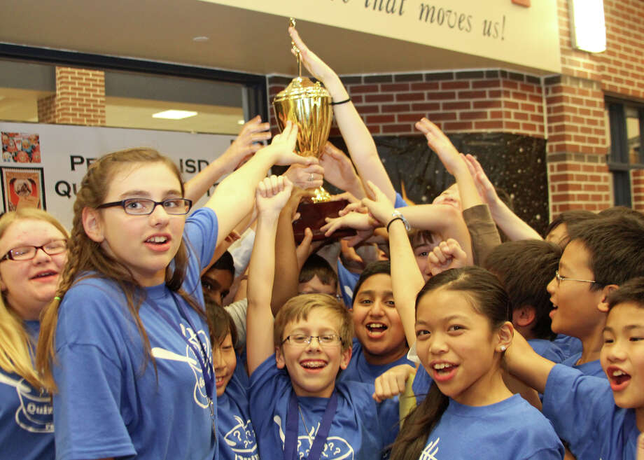 Rogers Middle School teammates celebrate their Quiz Bowl grand championship.