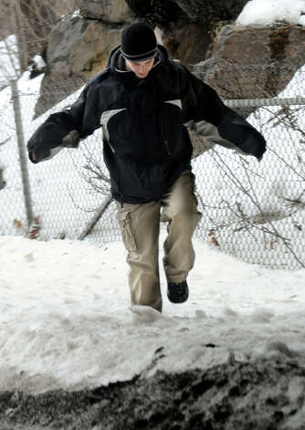 Brandon LaMontagne, 19, of Danbury, trudges through the snow on a sidewalk near the highway overpass on North Street, in Danbury, Conn., Tuesday, Feb. 12, 2013. A blizzard dumped almost 2 feet of snow on the Danbury area last Friday and Saturday. Photo: Carol Kaliff / The News-Times