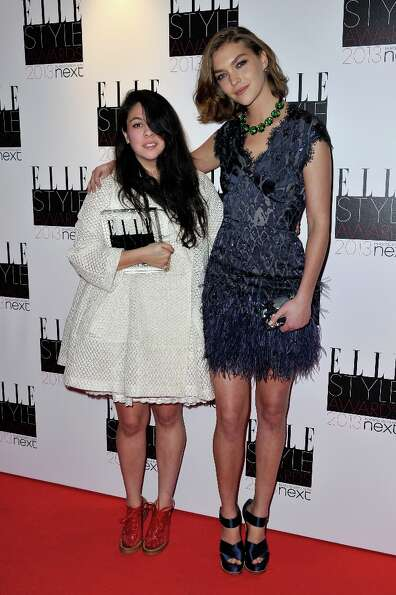 Arizona Muse and Next Young Designer of the Year winner Simone Rocha poses in the press room during