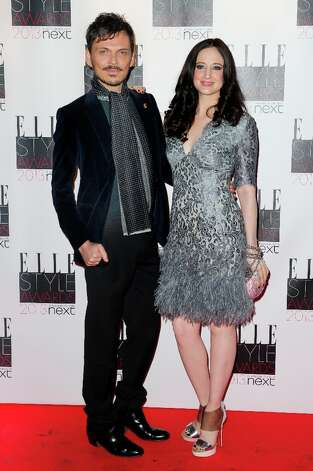 British designer Matthew Williamson and Andrea Riseborough arrive for the Elle Style Awards at a central London venue, Monday, Feb. 11, 2013, in London. (Photo by Jonathan Short/Invision/AP) Photo: Jonathan Short, Associated Press / Invision