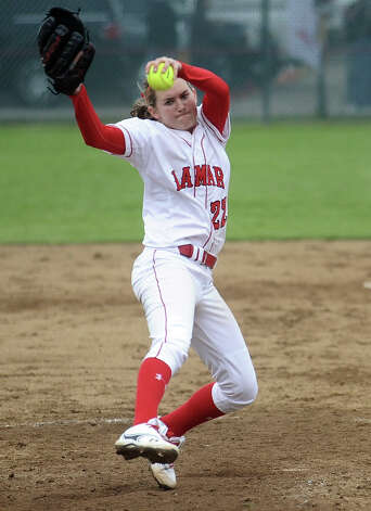 Lamar pitcher Shannon Millman, #22, throws a strike during the Lamar University softball game against UTSA at Ford Park on Saturday, February 9, 2013.  Lamar won over UTSA 3-2. Photo taken: Randy Edwards/The Enterprise Photo: Randy Edwards