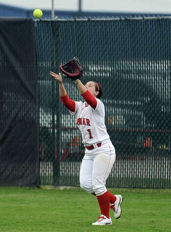 Lamar player Julianne Viator, #1, catches a pop fly during the Lamar University softball game against UTSA at Ford Park on Saturday, February 9, 2013.  Lamar won over UTSA 3-2. Photo taken: Randy Edwards/The Enterprise Photo: Randy Edwards