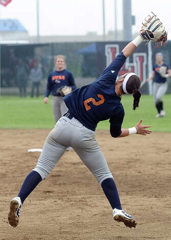 UTSA player Courtney Buchman, #2, makes a great catch at second place during the Lamar University softball game against UTSA at Ford Park on Saturday, February 9, 2013.  Lamar won over UTSA 3-2. Photo taken: Randy Edwards/The Enterprise Photo: Randy Edwards