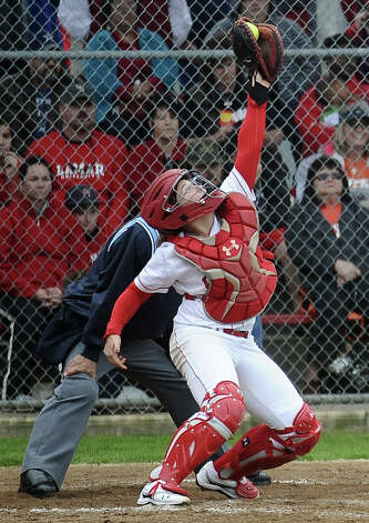Lamar player Beverly Corry, #9, makes a great stop behind the plate on a wild pitch during the Lamar University softball game against UTSA at Ford Park on Saturday, February 9, 2013.  Lamar won over UTSA 3-2. Photo taken: Randy Edwards/The Enterprise Photo: Randy Edwards