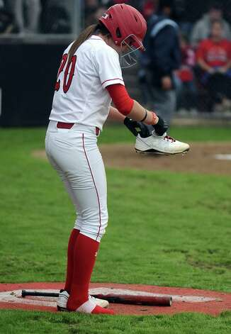 Lamar player Ashley McDowell, #20, shakes some rocks out of her shoe during the Lamar University softball game against UTSA at Ford Park on Saturday, February 9, 2013.  Lamar won over UTSA 3-2. Photo taken: Randy Edwards/The Enterprise