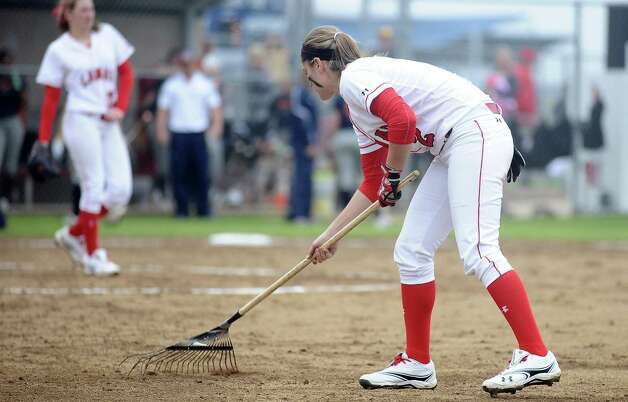 Lamar player Taylor Duck, #2, rakes the field at the top of the fourth during the Lamar University softball game against UTSA at Ford Park on Saturday, February 9, 2013.  Lamar won over UTSA 3-2. Photo taken: Randy Edwards/The Enterprise Photo: Randy Edwards