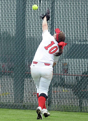 Lamar player Tina Shultz, #10, cannot make the catch during the Lamar University softball game against UTSA at Ford Park on Saturday, February 9, 2013.  Lamar won over UTSA 3-2. Photo taken: Randy Edwards/The Enterprise Photo: Randy Edwards