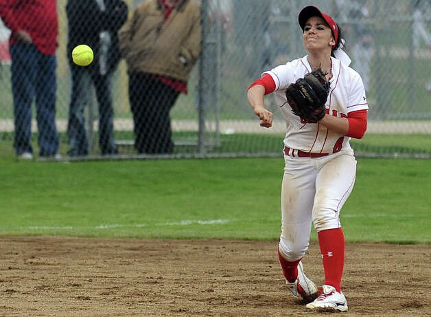 Lamar player Stephanie Meeuwsen, #6, throws out a player at first during the Lamar University softball game against UTSA at Ford Park on Saturday, February 9, 2013.  Lamar won over UTSA 3-2. Photo taken: Randy Edwards/The Enterprise Photo: Randy Edwards